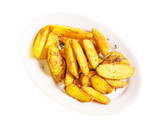 roasted potato wedges on a white plate