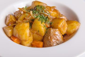 Beef bourguignon stew with roast potatoes