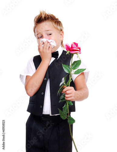 boy having allergy to flowers