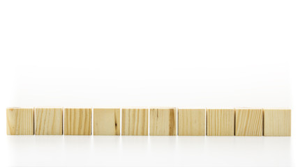 Row of ten blank wooden blocks