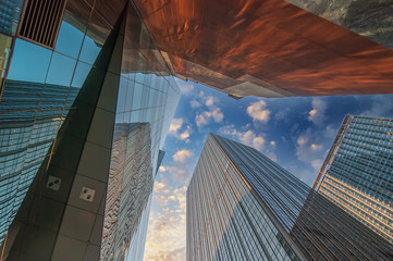 Skyward view of gigantic glass skyscrapers