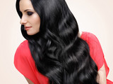 Hair. Portrait of Beautiful Woman with Black Wavy Hair.