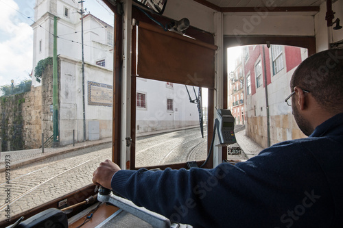 interior view of tram conductor in Lisbon, Portugal.