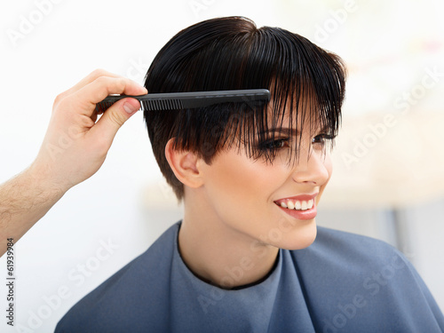 Hair. Hairdresser doing Hairstyle.  Beauty Model Woman. Haircut.