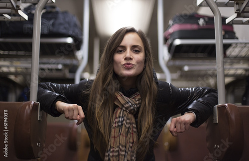 beautiful girl sending a kiss through the train