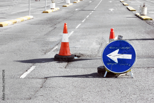 Road detour sign and cones due pothole