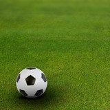 soccer ball on green football field