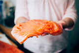Fresh piece of fresh raw salmon.woman hands