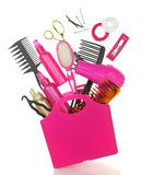 Fototapety Various hairstyling equipment in shopping bag isolated on white