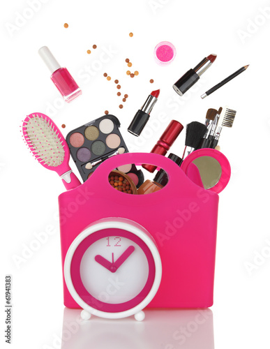 Pink shopping bag and clock with various cosmetics isolated