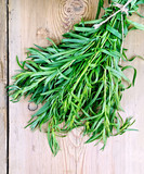 Tarragon on a wooden board