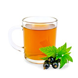 Tea with black currant in glass mug