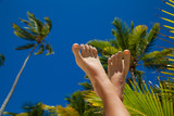 Woman's legs on holiday background
