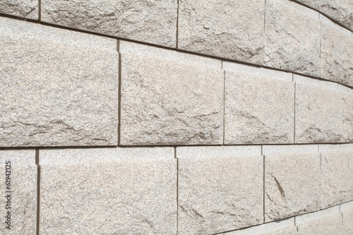 background of natural brown stone block wall