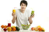 Happy man holding organic smoothie, fruits, salad,healthy food