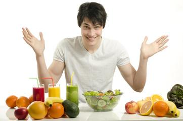 Happy man having organic smoothie, fruits, salad,healthy food