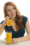 Happy woman preparing orange organic smoothie,squeazing orange