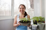 woman  with pots of seedlings