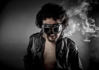 Hot, biker with sunglasses era dressed Leather jacket, huge smok