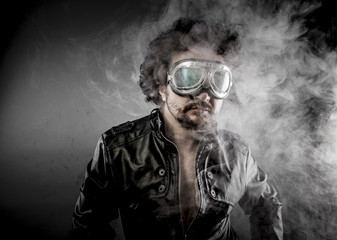 Motorcyclist, biker with sunglasses era dressed Leather jacket,