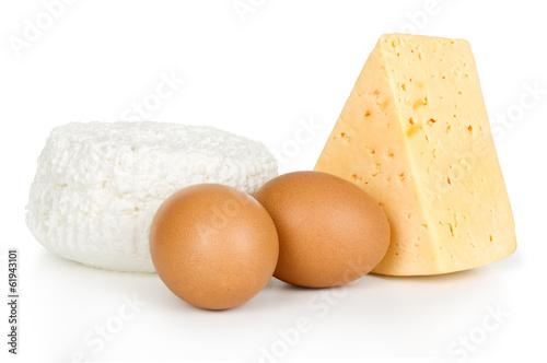 Leinwandbild Motiv eggs and cheese isolated on a white background