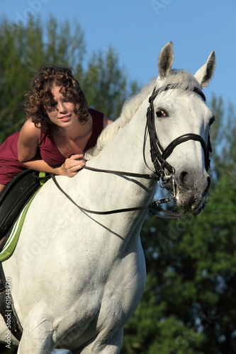 Girl laying relaxed bareback on her horse