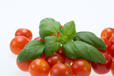 fresh cherry tomatoes with basil, on white background