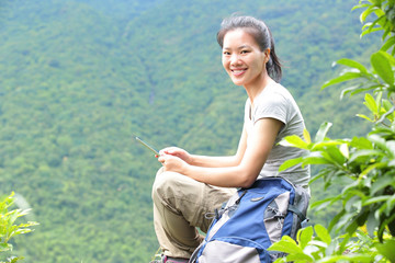 woman hiker use digital tablet mountain peak