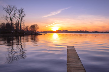 Purple Sunset over Wooden Jetty in Groningen, Netherlands