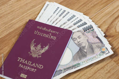 Japanese banknotes and Thailand passport