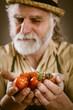 farmer shows his biological vegetables