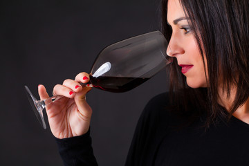 Wine expert smelling the aroma of a wine.
