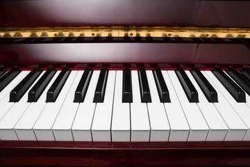 ebony and ivory keys of red piano