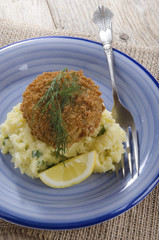 salmon fishcake coated in brown breadcrumbs