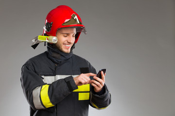 Firefighter using smart phone.