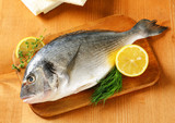 Fresh sea bream on cutting board