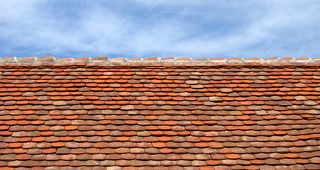 Roof tiles and sky