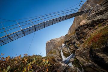 Hiking bridgein Sweden in Autumn