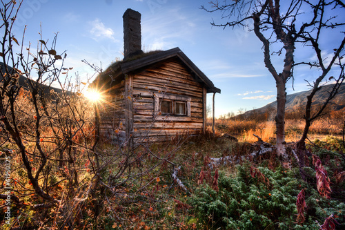 old hut in the wilderness of sweden at sunrise