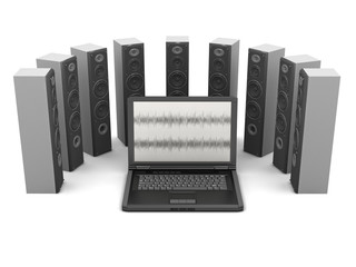 Laptop computer and audio speakers on white background