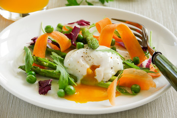 Summer salad with poached egg.