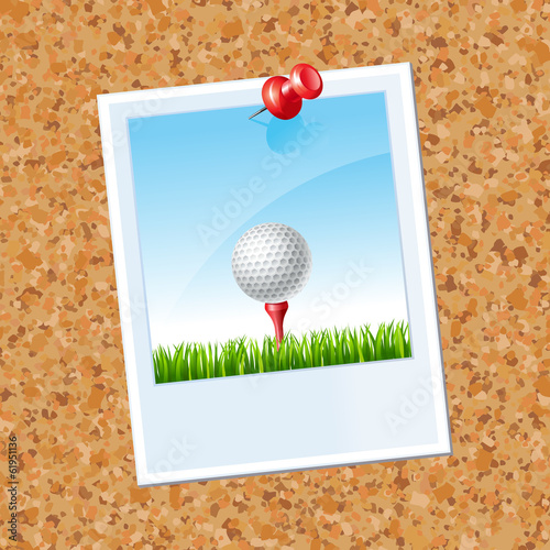 board with a photo a Golf ball