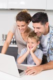 Parents using laptop with their son