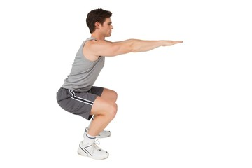 Fit man doing squats