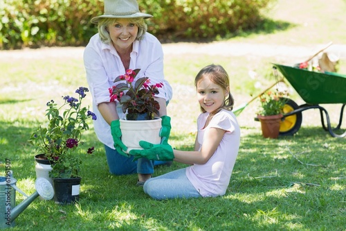 canvas print picture Grandmother and granddaughter engaged in gardening