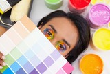 Portrait of a young woman with paint samples
