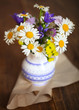 Bouquet of wildflowers on a rustic table
