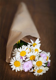 Small bouquet of wildflowers on a rustic table