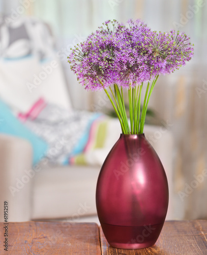 Giant Onion (Allium Giganteum) flowers in the flower vase on tab