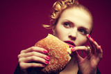 Unhealthy eating. Junk food concept. Girl eating burger